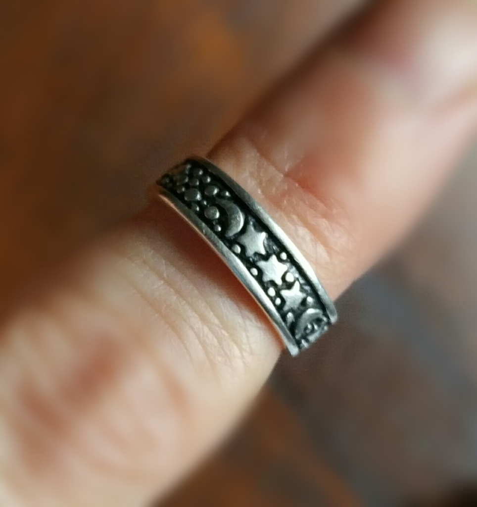 Silver patina on a celestial toe ring.