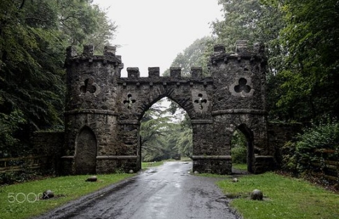Ancient ruin of a castle gate with clover windows.