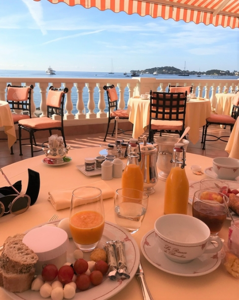 Tablescape overlooking a sea at breakfast.