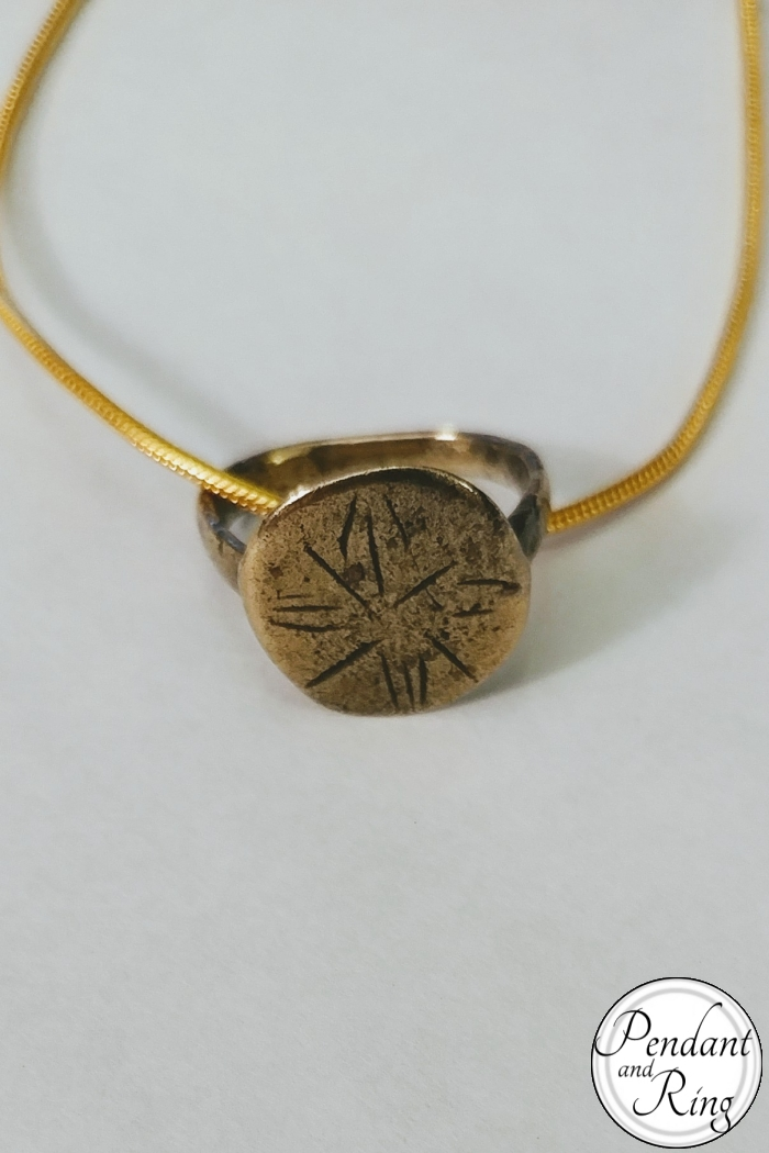 Medieval floral design on tiny ancient restored ring as a pendant on a gold filled necklace.