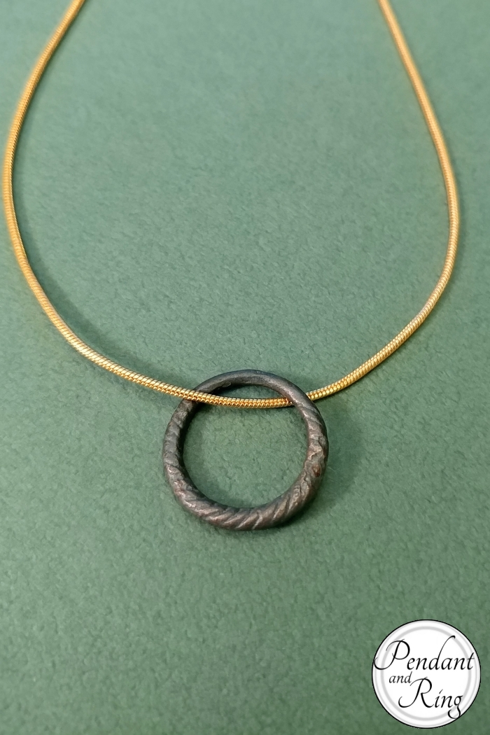 Twisted metal antique ring, restored and presented on a gold filled chain necklace.